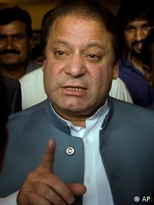 Former Prime Minister Nawaz Sharif gestures as he talks to the media after a press conference in Islamabad. (AP Photo/Emilio Morenatti, File)