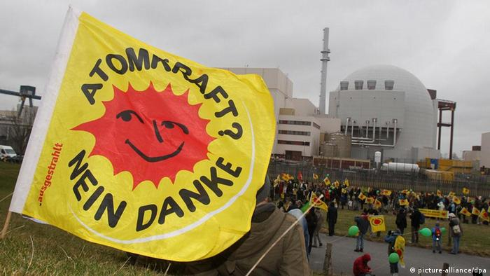 Anti-nuclear demonstrators hold flag at Brokdorf plant