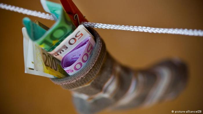 Euro banknotes in a sock