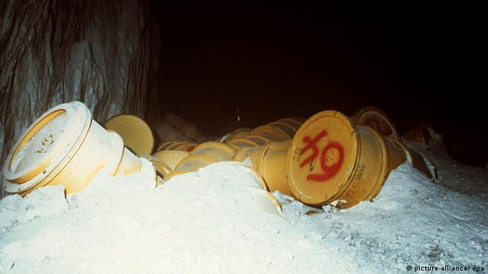 Barrels of nuclear waste lie on the ground in Asse.