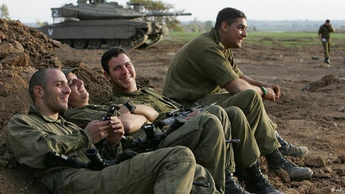 Israeli soldiers relax at a military staging area near Kibbutz Mefalsim, in southern Israel on the border with the Gaza Strip, Sunday, Nov. 26, 2006. (Photo: Oded Blilty)