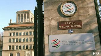 The entrance of the World Trade Organization's ( WTO ) headquarters, in background, shows panels in color of the WTO and the name of Swiss initiator William Rappard, in Geneva, Switzerland, on Tuesday, Dec.19, 2000.)
