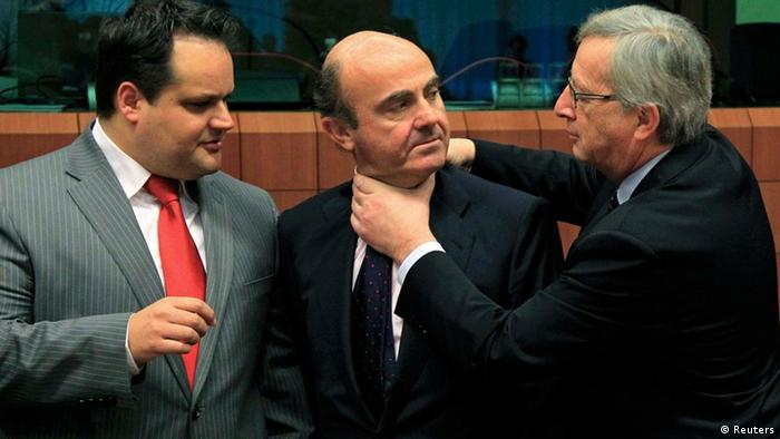 Juncker greets Spain's Economy Minister Luis de Guindos while Dutch Finance Minister Jan Kees de Jager looks on at a Eurogroup meeting in Brussels in March 2012. (Photo: REUTERS/Yves Herman)