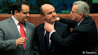 Euro Group, Brussels, March 2012. Juncker playfully grabs a fellow MEP, who looks unamused, by the throat.