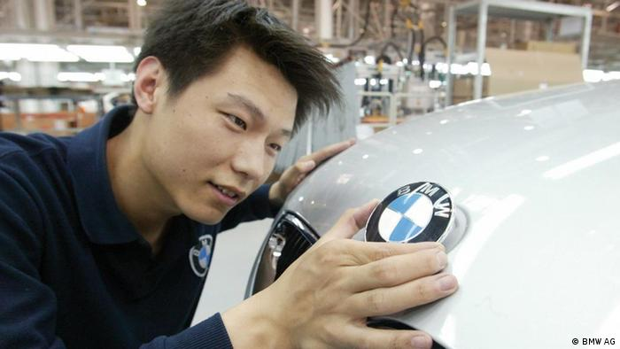 Chinese worker checking a BMW car