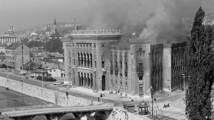 Combo photographs show Sarajevo's National Library burn due to Bosnian Serb shelling in 1992, top, and restored in a photograph made on Thursday Nov. 17, 2005. (Photo: ddp images/AP Photo/Hidajet Delic)