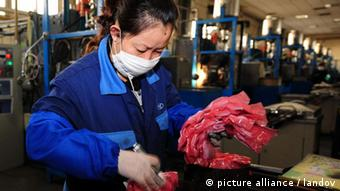 A worker packs products made with rare earths