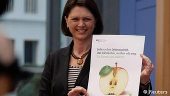 Agriculture and Consumer Minister Ilse Aigner with a campaign promotion poster