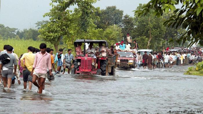 People dispaced by monsoon flooding, India.