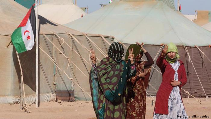 Western Sahara women flash 'victory sign' in refugee camp in Tifariti in the liberated territories of Western Sahara