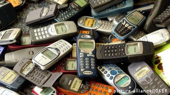 A heap of old mobile phones