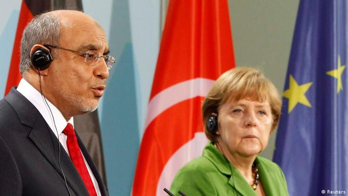 Tunisia's Prime Minister Hamadi Jebali (L) and German Chancellor Angela Merkel address a news conference at the Chancellery in Berlin March 14, 2012. REUTERS/Fabrizio Bensch (GERMANY - Tags: POLITICS)