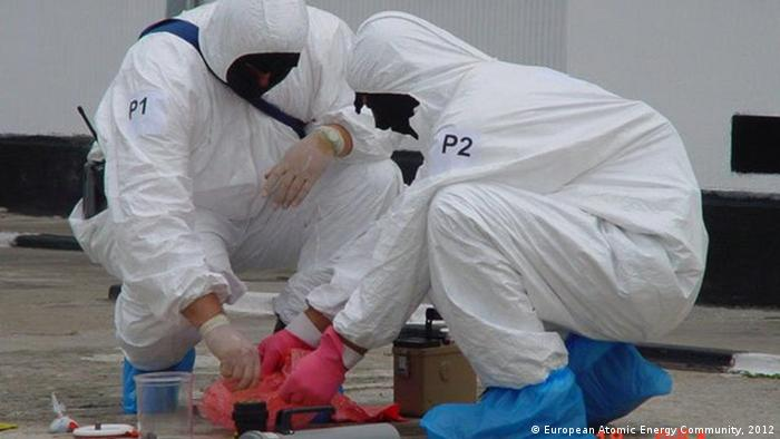 Forensic nuclear scientists taking samples