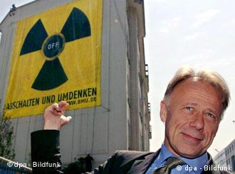Then Environment Minister Juergen Trittin unveils a nuclear power: off poster on the ministry's wall in 2005