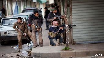 Syrian rebels take position during clashes with Syrian Army forces