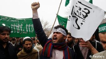An Afghan protester shouts anti-US slogans during a demonstration in Jalalabad province, against Sunday's shooting of at least 16 villagers by a U.S. Army staff sergeant in the volatile Afghan province of Kandahar, March 13, 2012. (Photo:REUTERS/ Parwiz )