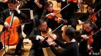 South Korean conductor Chung Myung-whun, bottom right, directs the last rehearsal of members of North Korea's Unhasu Orchestra with the Radio France Philharmonic Orchestra at the Salle Pleyel Concert Hall in Paris