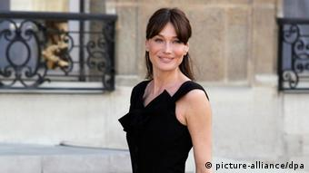 French first lady Carla Bruni Sarkozy is seen at the Elysee Palace, in Paris, France, 13 July 2010 after a tea reception with several African Leaders spouses. Fourteen African countries will be honour guest and will parade beside the French army on the Champs Elysees during the French traditional parade on 14 July 2010. EPA/LUCAS DOLEGA