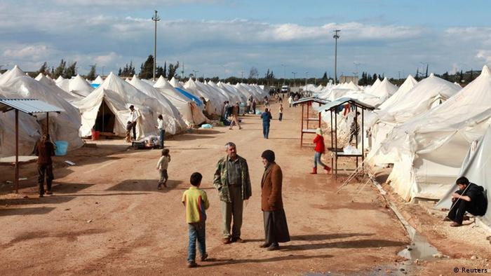 Syrian refugees stroll at Reyhanli refugee camp in Hatay province on the Turkish-Syrian border March 15, 2012.