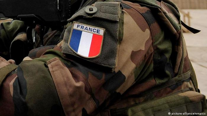 A french flag badge on the sleeve of a soldier's uniform