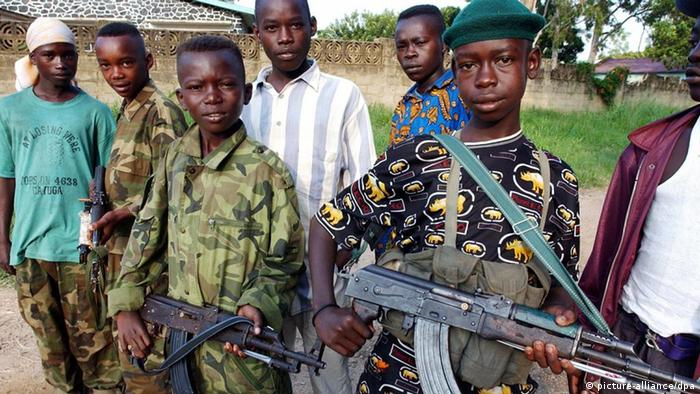 A group of armed child soldiers in DRC