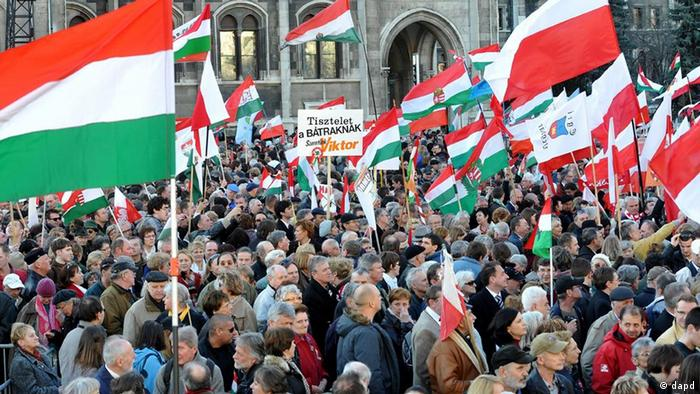 Participants of the Peach March among them Polish sympathizers of Hungary and the government of Viktor Orban raise Polish and Hungarian flags and placards as they attend the celebration on the Kossuth Square in front of the Hungarian Parliament building
