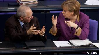 Merkel talking to Schaeuble in the Bundestag