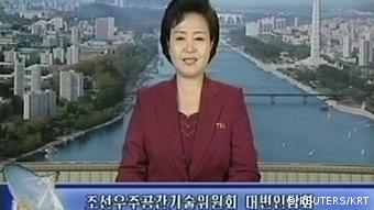 A North Korean Television KRT news reader announces the launch of a working satellite (Photo: REUTERS/KRT via Reuters TV)