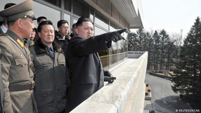 North Korean leader Kim Jong-un points towards South Korea as he visits the truce village of Panmunjom in the demilitarised zone separating the two Koreas, south of Pyongyang in this undated picture released by the North's KCNA news agency on March 4, 2012. REUTERS/KCNA (NORTH KOREA - Tags: POLITICS MILITARY) THIS IMAGE HAS BEEN SUPPLIED BY A THIRD PARTY. IT IS DISTRIBUTED, EXACTLY AS RECEIVED BY REUTERS, AS A SERVICE TO CLIENTS. NO THIRD PARTY SALES. NOT FOR USE BY REUTERS THIRD PARTY DISTRIBUTORS. QUALITY FROM SOURCE