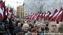 Latvian Waffen-SS veterans and their supporters marching and laying flowers to the Freedom Monument in central Riga on the anniversary of founding of the Latvian legion of Waffen-SS on March 16, 2010.