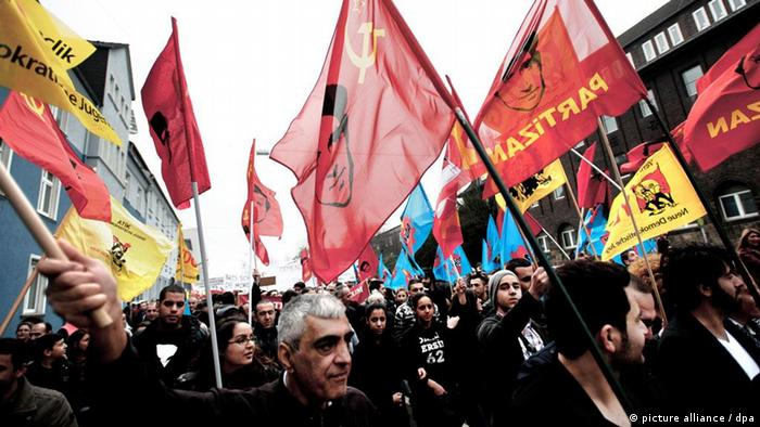Members of the Alevi community in Germany demonstrate against Erdogan