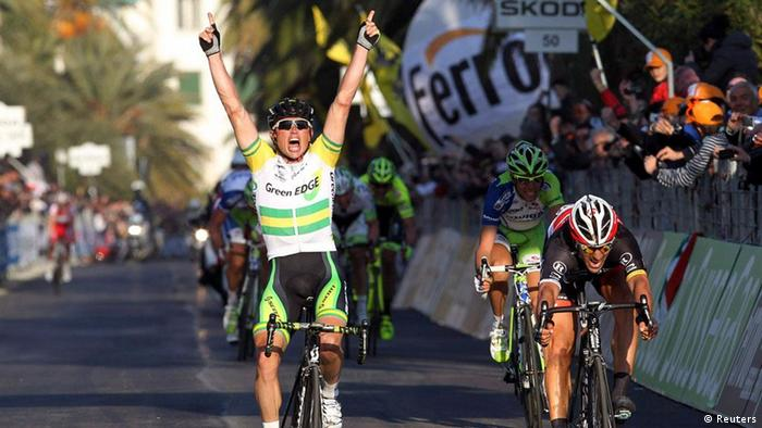 GreenEdge rider Simon Gerrans (front L) of Australia celebrates as he crosses the finish line to win ahead of Radioshack rider Fabian Cancellara (front R) of Switzerland at the Milan-San Remo Classic road race in San Remo March 17, 2012. REUTERS/Alessandro Garofalo (ITALY - Tags: SPORT CYCLING)