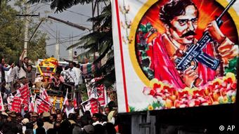 Relatives and supporters accompany the body of Kishenji, a senior Maoist rebel leader killed in a gunbattle with security forces in eastern India, during his funeral procession at Peddapally village in Karimnagar District of Andhra Pradesh, India, Sunday, Nov. 27, 2011. The government has called the rebels, who are now spread across 20 of India's 28 states, the country's greatest internal security threat. Inspired by Chinese revolutionary leader Mao Zedong, the rebels have fought for more than four decades demanding land and jobs for farmers and the poor. (AP Photo/Mahesh Kumar A.)