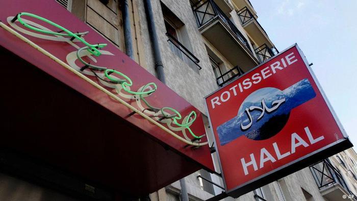Halal signs seen at a butcher shop in Paris