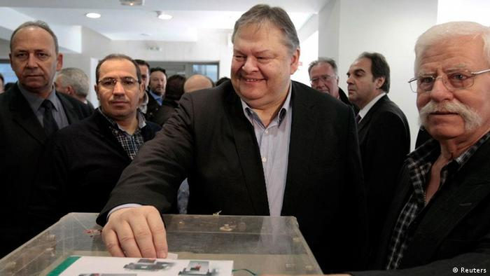Greece's Finance Minister Evangelos Venizelos casts a ballot during an election procedure for a new leader of the PASOK Socialist party in Athens March 18, 2012. Venizelos is expected to win the election and take over the leadership of the Socialists ahead of a snap parliamentary election planned for April or early May. REUTERS/Yiorgos Karahalis (GREECE - Tags: POLITICS BUSINESS)