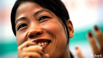 Indian ace boxer M.C. Mary Kom smiles as he replies to journalists' questions during a press conference held by Olympic Gold Quest & Sports Mechanics, a foundation started by former Indian sportsmen to further India's dream of winning gold medals in Olympics, in New Delhi, India, Tuesday, July 26, 2011. India, a country of over a billion people, has only one individual gold medal at the Olympics.