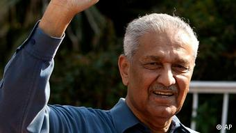 Pakistani nuclear scientist Abdul Qadeer Khan waves outside his residence in Islamabad, Pakistan