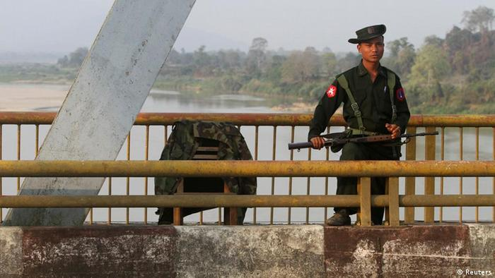 A Myanmar government soldier stands guard on Balaminhtin bridge over the Irrawaddy River near the city of Myitkyina in the north of the country after months of renewed fighting between government troops and the Kachin Independence Army, or KIA, February 22, 2012. Set up in the early 1960s, the KIA is one of the biggest ethnic armed groups that still has not signed a peace agreement with the government. There have been fierce battles between the KIA and government troops since last year while representatives from both sides have been holding peace talks for about six times, including twice in Ruili, a border town in neighbouring China. At the same time, thousands of local people have fled to Chinese border and bigger towns inside the Kachin State to escape the battle.REUTERS/Strinter (MYANMAR - Tags: MILITARY POLITICS SOCIETY)