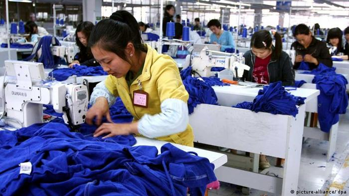 Chinese factory workers make clothes to be exported at a garment factory in Haian county