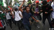 Indonesian students shout slogans during a demonstration