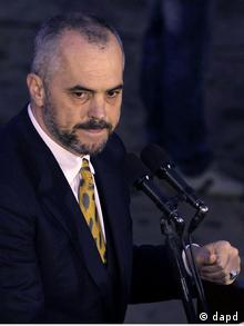 Opposition Socialist Party leader Edi Rama speaks to supporters in an anti-government protest in the village of Gerdec, 15 kilometers west of capital Tirana Tuesday, March 15, 2011. Several thousand opposition supporters have protested against the Albanian government on the third anniversary of the death of 26 people in blasts at an ammunition disposal factory. The opposition blames the explosions in Gerdec, near Tirana, in 2008 on corrupt officials in the ruling coalition. (Foto:Hektor Pustina/AP/dapd)