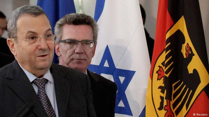 German Defence Minister Thomas de Maiziere (R) and Israel's counterpart Ehud Barak arrive for a news conference after talks in Berlin March 20, 2012. REUTERS/Tobias Schwarz (GERMANY - Tags: POLITICS MILITARY)
