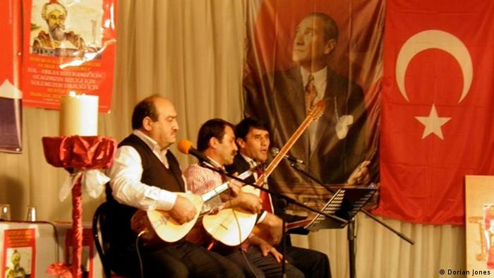 Musicians play at Alevi gathering in Istanbul