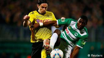 Spvgg Greuther Fuerth's Olicer Occean (R) challenges Borussia Dortmund's Neven Subotic