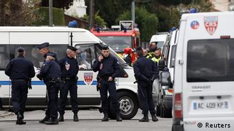 French CRS police block a street during a raid on a house to arrest a suspect in the killings of three children and a rabbi on Monday at a Jewish school, in Toulouse March 21, 2012. About 300 police, some in bullet-proof body armour, cordoned off an area surrounding an apartment in a Toulouse neighbourhood in southwestern France, where the 24-year-old Muslim man was holed up. Shots were heard in the early hours of the morning, and police said three officers had been slightly wounded. REUTERS/Jean-Paul Pelissier (FRANCE - Tags: CRIME LAW CIVIL UNREST)