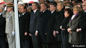 French electoral candidates standing in line at Montauban funeral for the three soldiers killed last week. Pictured are (From L to 2nd R): Francois Hollande, Socialist party candidate for the 2012 French presidential election, Nicolas Dupont-Aignan, Debout La Republique group candidate for the 2012 French presidential election, Francois Bayrou, MoDem party candidate for the 2012 French presidential election, an unidentified man, Marine Le Pen, France's National Front head and far right candidate for 2012 French presidential election, Europe Ecologie-Les Verts Green Party's Senator Esther Benbassa and Eva Joly, Europe Ecologie-Les Verts Green Party candidate for the 2012 French presidential election. REUTERS/Philippe Wojazer