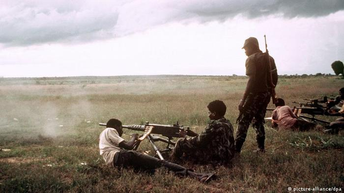 Angola's UNITA rebels shooting a machine gun