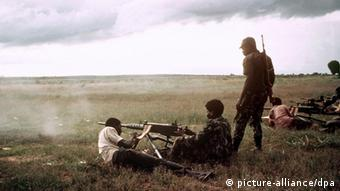 Angola's UNITA rebels shooting a machine gun