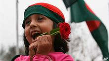 A Bangladeshi girl has her head covered with national flag as she holds a rose during Independence day celebrations in Dhaka, Bangladesh, Thursday, March 26, 2009. Bangladeshis celebrated 38 years of independence Thursday amid tight security as tens of thousands of people visited a national memorial outside the capital to mark the independence from Pakistan in which millions of people died. (AP Photo/Pavel Rahman)