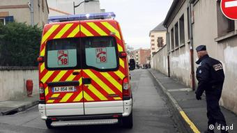 An ambulance arrives on the scene to evacuate injured policemen during a raid on a five-storey building to arrest a suspect in the killings of three children and a rabbi on Monday at a Jewish school, in Toulouse March 22, 2012. An al Qaeda-inspired gunman who killed seven people in France is dead after police stormed his apartment in the southern city of Toulouse, French media reported on Thursday. REUTERS/Pascal Parrot (FRANCE - Tags: CRIME LAW CIVIL UNREST)